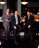 California, USA, portrait of men holding wine at the oyster bar at Osteria Mozza.