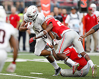 Northern Illinois Huskies running back Joel Bouagnon (28) gets wrapped up by Ohio State Buckeyes linebacker Raekwon McMillan (5) and Ohio State Buckeyes safety Tyvis Powell (23) during the second half of the NCAA football game between the Ohio State Buckeyes and the Northern Illinois Huskies at Ohio Stadium on Saturday, September 19, 2015. (Columbus Dispatch photo by Jonathan Quilter)