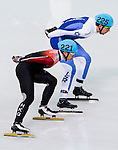 Tianyu Han of Hong Kong being followed during the Short Track Speed Skating as part of the 2014 Sochi Olympic Winter Games at Iceberg Skating Palace on February 10, 2014 in Sochi, Russia. Photo by Victor Fraile / Power Sport Images