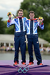 LONDON, ENGLAND - AUGUST 7:  Alistair Brownlee of Great Britain and Johnathan Brownlee of Great Britain celebrate their gold and bronze respectively during the Men's Triathlon Final, Day 12 of the London 2012 Olympic Games on August 7, 2012 at Hyde Park in London, England. (Photo by Donald Miralle)