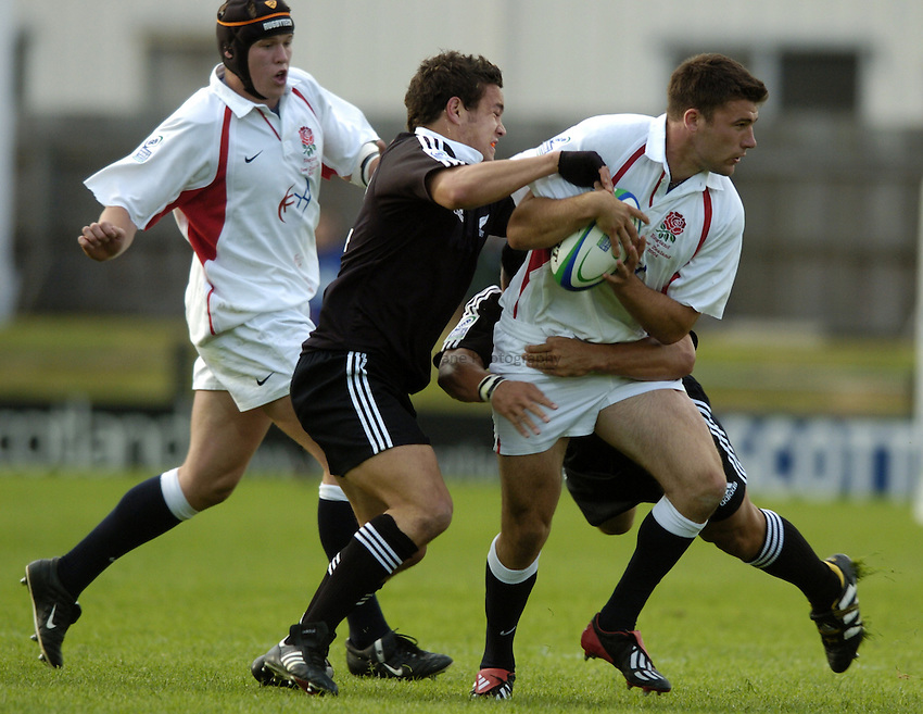 Photo. Jed Wee..England U21 v New Zealand U21, IRB U21 World Championship, 11/06/2004..England's Chris Bell (R) with New Zealand's John Pareanga.