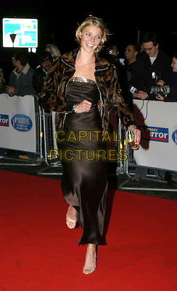 JODIE KIDD.Daily Mirror's Pride Of Britain Awards at the London Hilton, Park Lane.15 March 2004.full length, full-length, long brown dress, gold strappy sandals, laughing.www.capitalpictures.com.sales@capitalpictures.com.© Capital Pictures.