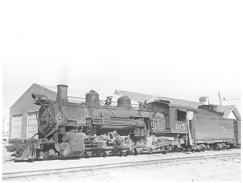Fireman side of D&amp;RGW #495 K-37 with station behind train.<br /> D&amp;RGW  Farmington, NM  Taken by Payne, Andy M. - 12/2/1959