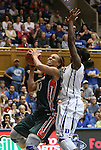 24 February 2012: Miami's Michelle Woods (10) goes for a shot against Duke's Elizabeth Williams (right). The Duke University Blue Devils defeated the University of Miami Hurricanes 74-64 at Cameron Indoor Stadium in Durham, North Carolina in an NCAA Division I Women's basketball game.