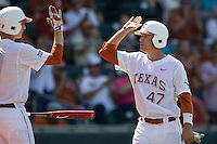Texas Longhorns outfielder Mark Gottsacker #47 is greeted by a teammate after he scored against the Oklahoma Sooners in the NCAA baseball game on April 6, 2013 at UFCU DischFalk Field in Austin, Texas. The Longhorns defeated the rival Sooners 1-0. (Andrew Woolley/Four Seam Images).