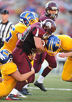 STAFF PHOTO ANDY SHUPE - Lincoln running back Dusty Hudson is tackled by members of the Hot Springs Lakeside defense during the first half of play Monday, Sept. 1, 2014, at Razorback Stadium in Fayetteville.