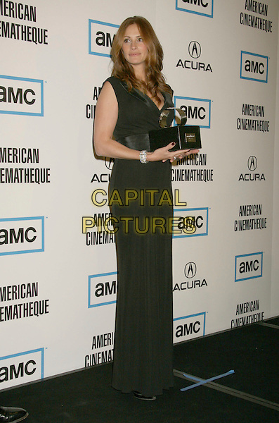 JULIA ROBERTS.The 22nd American Cinematheque Award Ceremony honoring Julia Roberts held at the Beverly Hilton Hotel, Beverly Hills, California, USA,.12 October, 2007..full length award trophy black dress.CAP/ADM/RE.©Russ Elliot/AdMedia/Capital Pictures.