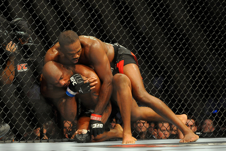 "24 SEPTEMBER 2011:  Jon ""Bones"" Jones gets into the final chokehold he needed to defeat Quinton ""Rampage"" Jackson   during UFC 135 at the Pepsi Center in Denver, Colorado. *****For Editorial Use Only*****"