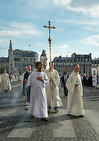 The procession and mass arranged by Notre Dame de Paris for the Fête de l'Assomption de la Vierge Marie (the Assumption of the Virgin Mary) on 15th August 2013. The procession (Procession Mariale) started at the Quai aux Fleurs on Ile de la Cité, just to the north of Notre Dame, then via Quai de la Corse and Bd du Palais, past the Sainte-Chapelle, over Pont Saint-Michel, eastwards along the quais to the south of the Seine, over Pont de la Tournelle on to Ile St Louis, then back to Notre Dame. Mass was then held at Notre Dame (Messe solonnelle de l'Assomption de la Vierge Marie). This was the second day of celebrations, following the river pilgrimage (the tenth) on the River Seine, the previous evening. Thursday 15th August 2013.