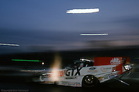 ENGLISHTOWN, NJ - MAY 23: John Force launches his Funny Car off the starting line during night qualifying for the Mopar Parts Nationals on May 23, 1999, at Old Bridge Township Raceway Park near Englishtown, New Jersey.