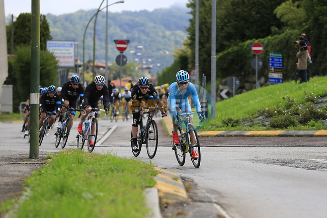 The peloton led by Valerio Agnoli (ITA) Astana and Team Sky speed through Calco during the last classic of the season Il Lombardia 2015 running 245km from Bergamo to Como, Italy. 4th October 2015.<br /> Picture: Eoin Clarke | Newsfile