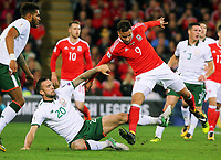 (L-R) Shane Duffy of Ireland challenges Hal Robson-Kanu of Wales during the FIFA World Cup Qualifier Group D match between Wales and Republic of Ireland at The Cardiff City Stadium, Wales, UK. Monday 09 October 2017