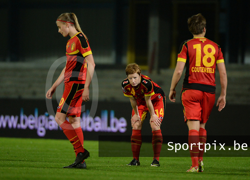 20140410 - LEUVEN , BELGIUM : Belgian players pictured feeling dejected and disappointed after their loss against Norway with Belgian Lien Mermans (middle) after the female soccer match between Belgium and Norway, on the seventh matchday in group 5 of the UEFA qualifying round to the FIFA Women World Cup in Canada 2015 at Stadion Den Dreef , Leuven . Thursday 10th April 2014 . PHOTO DAVID CATRY