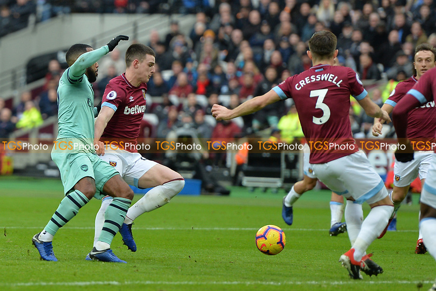 Declan Rice of West Ham United tackles  Alexandre Lacazetten of Arsenal during West Ham United vs Arsenal, Premier League Football at The London Stadium on 12th January 2019