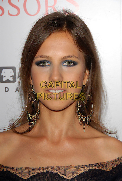 "ALLEGRA VERSACE.attends The TrisStar Pictures' World Premiere of ""Running with Scissors"" held at The Academy of Motion Pictures Arts & Sciences in Beverly Hills, California, USA, October 10th 2006..portrait headshot beck earrings eye make-up.Ref: DVS.www.capitalpictures.com.sales@capitalpictures.com.©Debbie VanStory/Capital Pictures"
