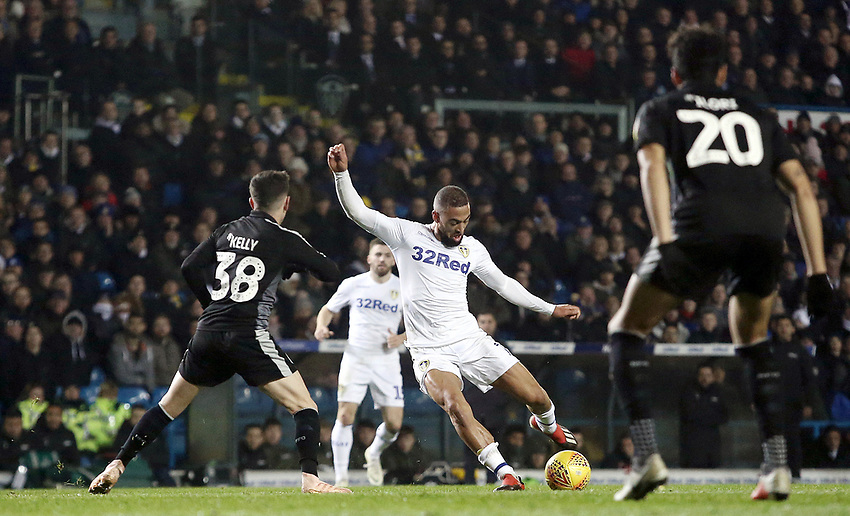 Leeds United's Kemar Roofe shoots despite the attentions of Reading's Liam Kelly<br /> <br /> Photographer Rich Linley/CameraSport<br /> <br /> The EFL Sky Bet Championship - Leeds United v Reading - Tuesday 27th November 2018 - Elland Road - Leeds<br /> <br /> World Copyright © 2018 CameraSport. All rights reserved. 43 Linden Ave. Countesthorpe. Leicester. England. LE8 5PG - Tel: +44 (0) 116 277 4147 - admin@camerasport.com - www.camerasport.com