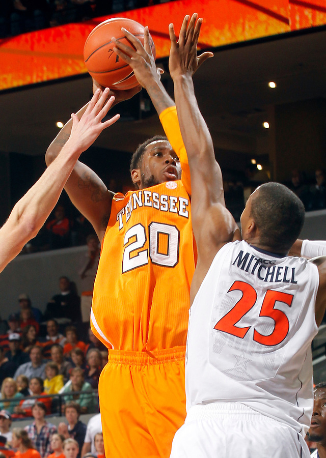 Tennessee forward Kenny Hall (20) shoots over Virginia forward Akil Mitchell (25) during the game Wednesday in Charlottesville, VA. Virginia defeated Tennessee 46-38.