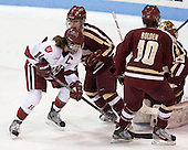 Jillian Dempsey (Harvard - 14), Emily Pfalzer (BC - 14), Blake Bolden (BC - 10) - The Boston College Eagles defeated the Harvard University Crimson 2-1 in the opening game of the 2013 Beanpot on Tuesday, February 5, 2013, at Matthews Arena in Boston, Massachusetts.
