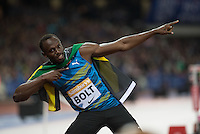 Usain BOLT of Jamaica (Men's 100m) does his trademark pose during the Sainsburys Anniversary Games Athletics Event at the Olympic Park, London, England on 24 July 2015. Photo by Andy Rowland.