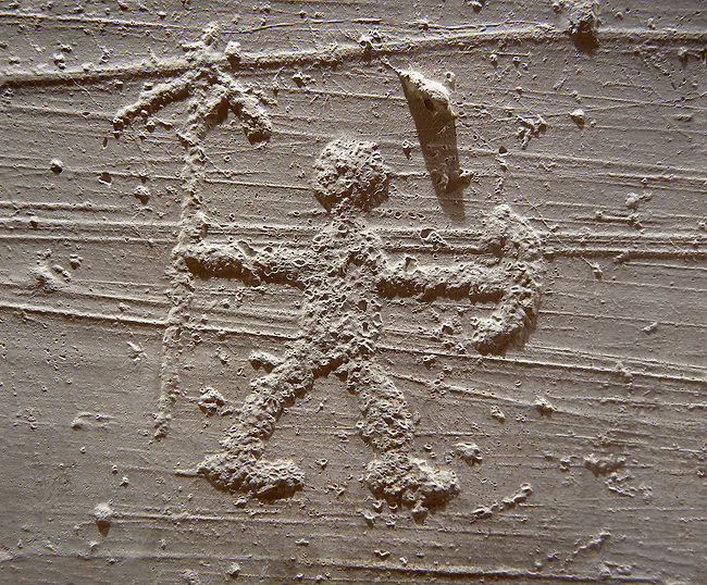 Cast of a prehistoric Petroglyph, rock carving, of a warrior with a spear and shield carved by the Camunni people in the iron age between 1000-1600 BC , Seradina rock 12, Seradina-Bedolina Archaeological Park Museum, Valle Comenica, Lombardy, Italy
