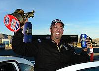 Oct. 28, 2012; Las Vegas, NV, USA: NHRA competition eliminator driver Bo Butner celebrates after winning the Big O Tires Nationals at The Strip in Las Vegas. Mandatory Credit: Mark J. Rebilas-