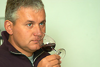 Joel Durand, owner and wine maker tasting a glass of red wine.  Domaine Eric et Joel Joël Durand, Ardeche, Ardèche, France, Europe