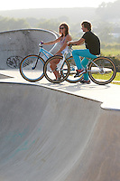 Clinton Johns on DMR jump bike , with girlfriend Georgina .  Hayle skatepark , Cornwall .