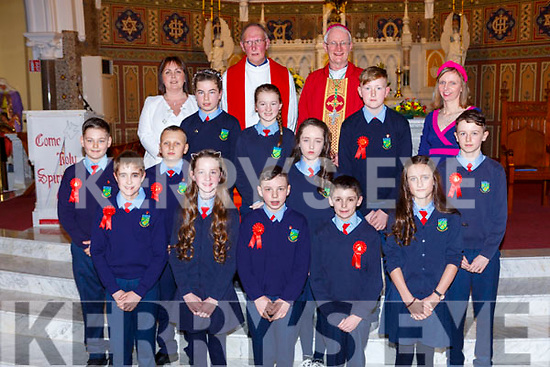 Pupils from Curranes NS with Bishop Ray Browne Principal and Fr Maurice Brick  and Principal Ms Eimear Nelligan and teacher Elizabeth Sweeney at the Confirmation in St Stephens and Johns church Castleisland on Thursday