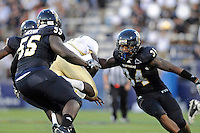 17 September 2011:  FIU linebacker Winston Fraser (34) combines with others to tackle UCF quarterback Jeff Godfrey (2) in the second quarter as the FIU Golden Panthers defeated the University of Central Florida Golden Knights, 17-10, at FIU Stadium in Miami, Florida.