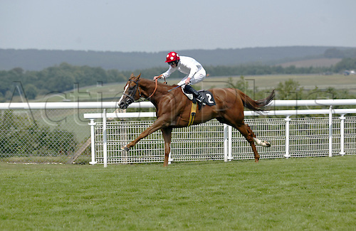 29 July 2004: Jockey RYAN MOORE drives PETER PAUL RUBENS to victory in the Albert Stakes at Goodwood Photo: Glyn Kirk/Action Plus...horse racing 040729 flat horses