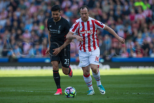 April 8th 2017, bet365 Stadium, Stoke on Trent, Staffordshire, England; EPL Premier League football, Stoke City versus Liverpool; Stoke City's Charlie Adam and Liverpool's Emre Can chase down a loose ball