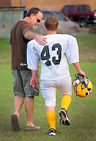 "Kelly.Jordan@jacksonville.com--101211--Yulee football player Jacob ""Jake"" Martin, right, whose practice number is (43), and game number is (30), walks off of the field with his father Jack Martin following football practice Wednesday October 12, 2011 at Yulee High School. When the Yulee High School football team played a game on one of ESPN's networks, it made Jacob Martin one of the co-captains. Martin, a senior, has Down syndrome and until this season, was a team manager. But this year he is a player who recently got into a game for the final play.(The Florida Times-Union, Kelly Jordan)"