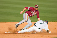 Shortstop Stephen Cardullo #38 of the Florida State Seminoles can't field the throw as Dave DiNatale #7 of the Miami Hurricanes steals second base at Durham Bulls Athletic Park May 21, 2009 in Durham, North Carolina.  (Photo by Brian Westerholt / Four Seam Images)