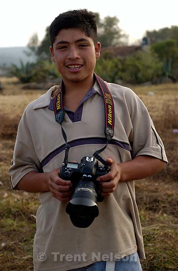 boy holding one of my cameras.. 12.04.2004<br />