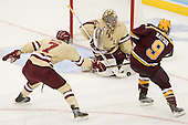 Isaac MacLeod (BC - 7), Parker Milner (BC - 35), Taylor Matson (Minnesota - 9) - The Boston College Eagles defeated the University of Minnesota Golden Gophers 6-1 in their 2012 Frozen Four semi-final on Thursday, April 5, 2012, at the Tampa Bay Times Forum in Tampa, Florida.