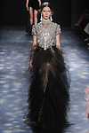Model Paula walks runway in a gunmetal, black diamond, opal crystal and pearl-jeweled necklace ball gown with cascading tulle skirt, from the Marchesa Fall 2016 collection by Georgina Chapman and Keren Craig, presented at NYFW: The Shows Fall 2016, during New York Fashion Week Fall 2016.