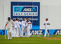 The Sri Lankan team celebrates as Brendon McCullum walks off after being dismissed for a duck during day one of the 2nd cricket test match between the New Zealand Black Caps and Sri Lanka at the Hawkins Basin Reserve, Wellington, New Zealand on Saturday, 3 February 2015. Photo: Dave Lintott / lintottphoto.co.nz