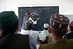 Mcc0027461 . Daily Telegraph..Boys in a maths class in Chah e Anjir, northern Nad e Ali, where 3 Para are based...Helmand 25 November 2010