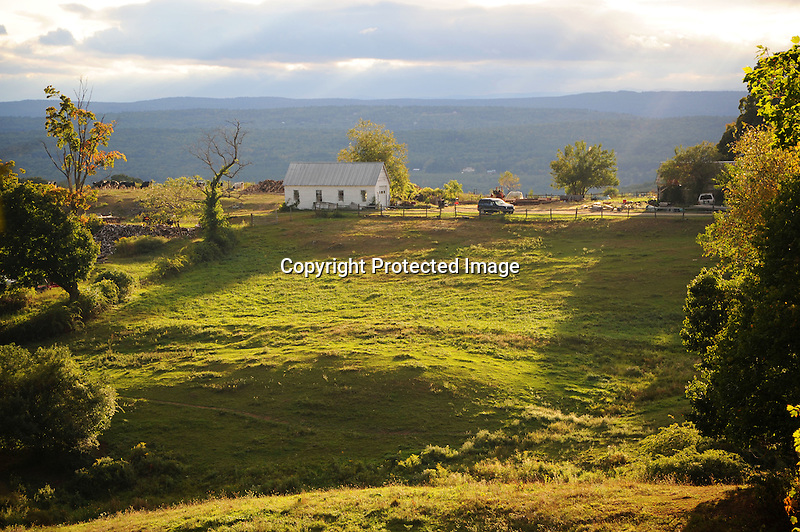 Hilltop dairy farm with late afternoon sun in Walpole, New Hampshire USA