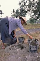 woman works preparing concrete.<br /> donna lavora preparando il cemento
