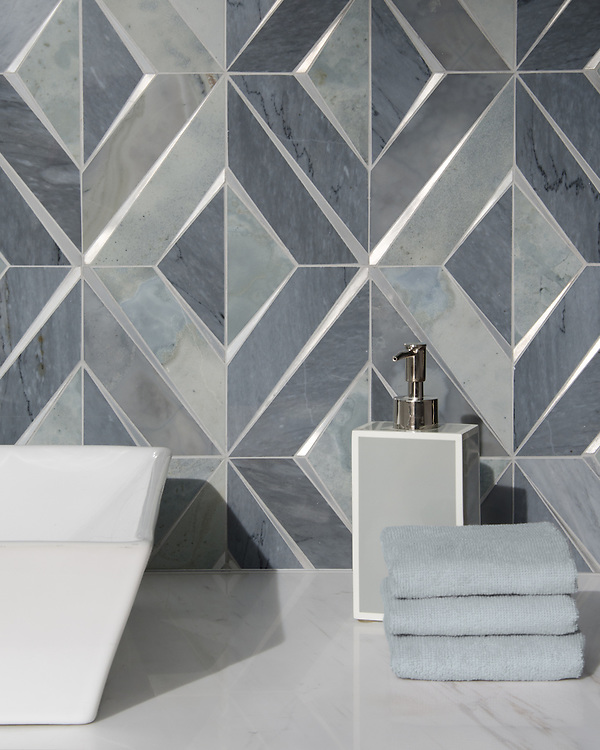 Simone, a waterjet stone mosaic, shown in polished Bardiglio and Pacifica with brushed Aluminum, is part of the Trove® collection for New Ravenna.<br />