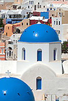 The traditional architecture of Santorini is similar to other islands in the Cyclades group. Perched on the cliffs of the caldera, cubical houses made of local stone and whitewashed or limewashed with volcanic ash are dotted with picturesque blue-domed churches.