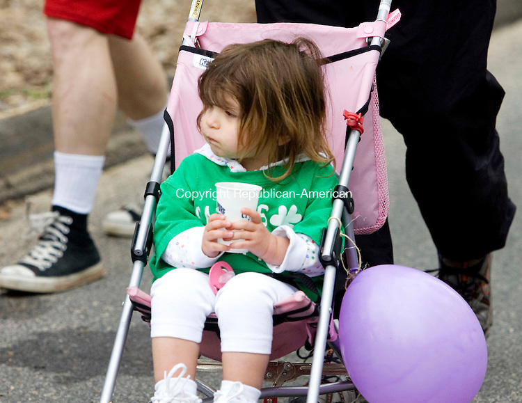 MIDDLEBURY, CT- 27 APRIL 2008- 042708JT01-<br /> Hannah Busillo, 21 months, of Branford, drinks water from a cup offered at a rest stop along the route for Sunday's March of Dimes March for Babies in Middlebury on Judd Hill Road. Busillo is wearing a shirt for Gavin's Wolfpack, a team walking for Gavin Perrone, 15 months, of Waterbury, who was born premature.<br /> Josalee Thrift / Republican-American