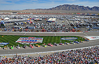 Mar. 1, 2009; Las Vegas, NV, USA; NASCAR Sprint Cup Series drivers line up on the track prior to the start of the Shelby 427 at Las Vegas Motor Speedway. Mandatory Credit: Mark J. Rebilas-