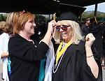 Melissa Amarillas helps her sister-in-law Kathi Trethewey with her cap before the Western Nevada College commencement at the Pony Express Pavilion, in Carson City, Nev., on Monday, May 19, 2014. A record-high 543 students graduate from WNC this week. <br /> Photo by Cathleen Allison/Nevada Photo Source