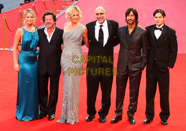 "JENNIFER LAWRENCE, JOAQUIM DE ALMEIDA, CHARLIZE THERON, GUILLERMO ARRIAGA, JOSE MARIA YASPIK & J.D. PARDO.""The Burning Plain"" Premiere during the 65th Venice Film Festival, Italy..August 29th, 2008.full length blue satin silk dress long maxi silk silver grey gray beaded beads suit suits cast director one shoulder hand in pocket .CAP/ADM/Liverani.©Liverani/AdMedia/Capital Pictures"
