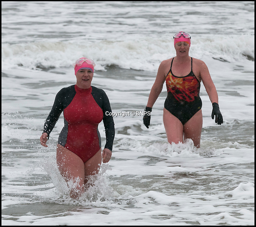 BNPS.co.uk (01202 558833)Pic: LeeMcLean/BNPS<br /> <br /> The toughest women in Britain...<br /> <br /> A group of swimmers braved the sub-zero temperatures this afternoon at Bournemouth beach while the 'Beast from the East' hits the South Coast.