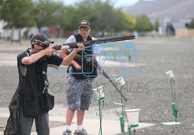 Robert Lamkin and Weston Swift, both 13, practice at the Capital City Gun Club, in Carson City, Nev., on Friday, July 11, 2014.<br /> Photo by Cathleen Allison
