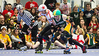 15 MAR 2014 - BIRMINGHAM, GBR - Team England jammer Reaper (left with red star) fends off a challenge from Wizards of Aus pivot Monkey Nuts (right) during the bout between the two teams at the inaugural Men's Roller Derby World Cup in the Futsal Arena in Birmingham, West Midlands, Great Britain (PHOTO COPYRIGHT © 2014 NIGEL FARROW, ALL RIGHTS RESERVED)