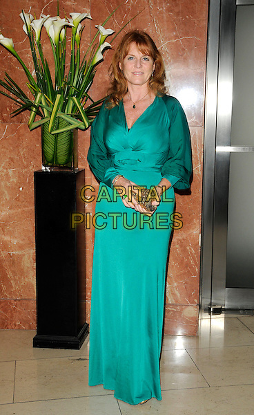 SARAH FERGUSON, DUCHESS OF YORK.attends ACLT Gift of Life Ball at Altitude 360, Millbank Tower, London, England, UK, October 10th 2009.full length long maxi dress green  Fergie royal sleeves gold clutch bag .CAP/CAN.©Can Nguyen/Capital Pictures